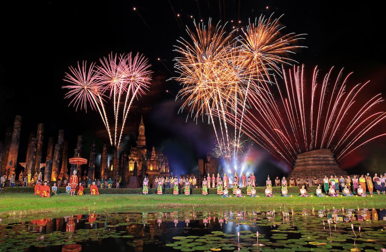 Traditional Thai in Loy Krathong festival showing in Wat Mahathat, Sukhothai historical park, Thailand