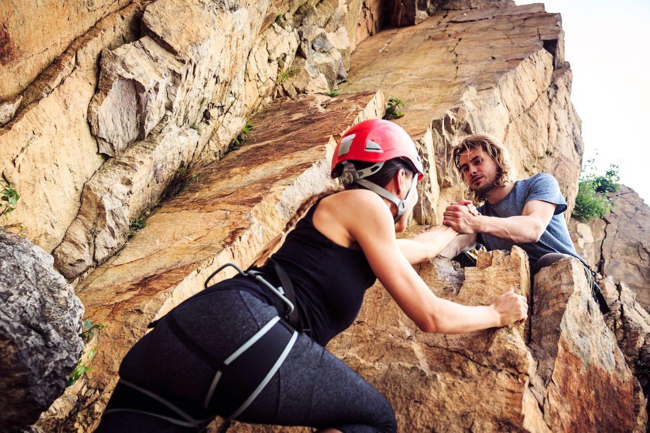 People rock climbing