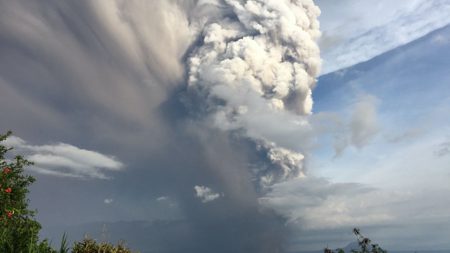 Philippine volcano erupts, forcing tens of thousands to flee their homes