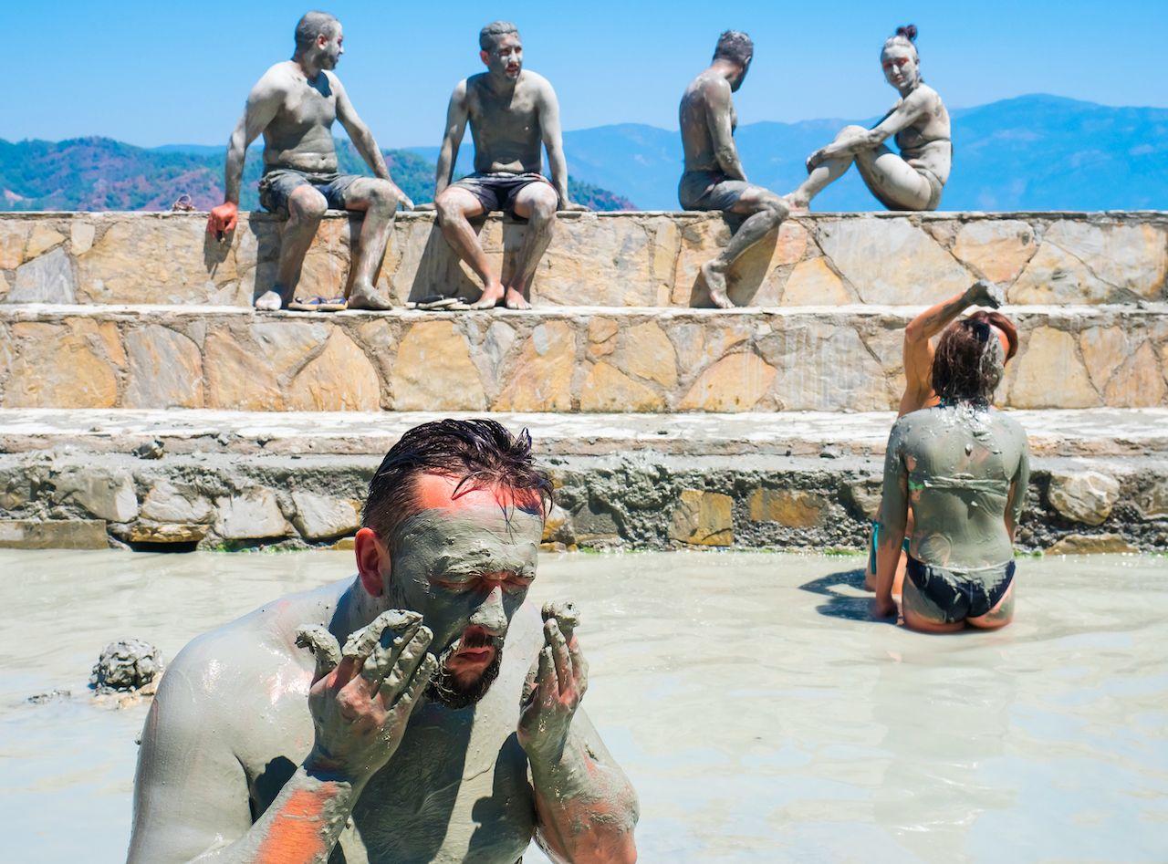 People taking a mud bath