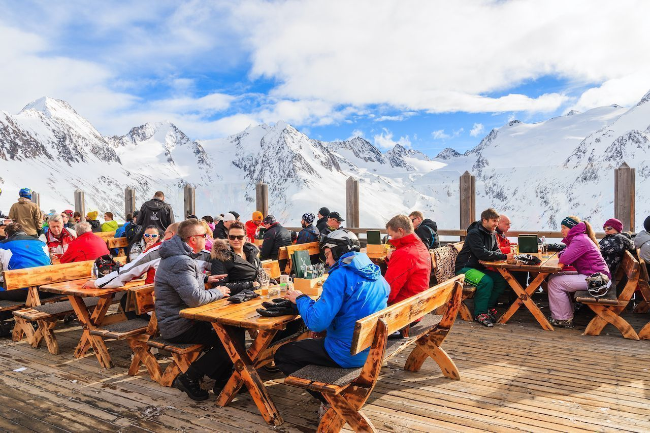 Skiers dining in mountain hut restaurant in Obergurgl ski area, Tirol, Austria