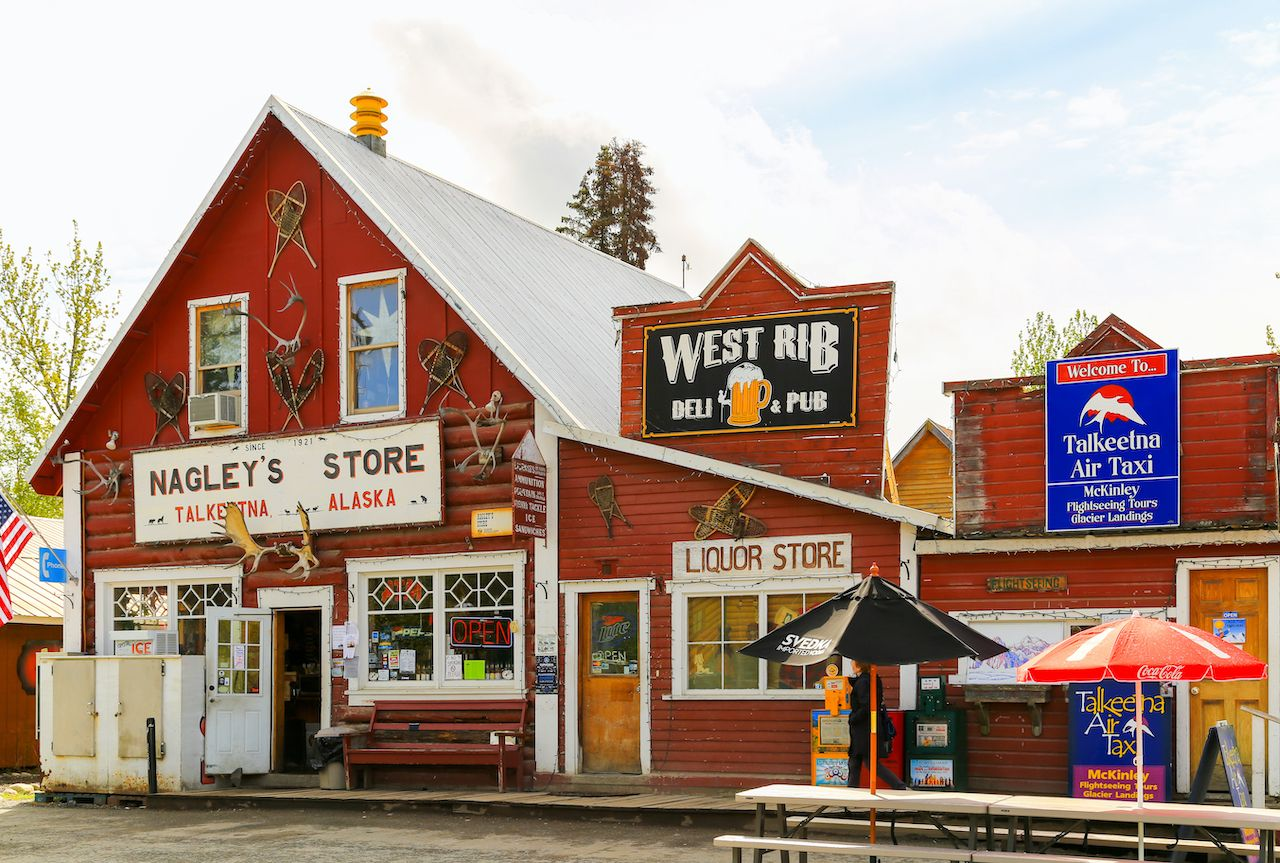 Facade of stores and pubs in the small oldtown of Talkeetna, Alaska