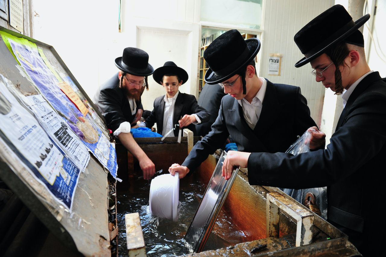 Orthodox Jewish men prepare for the Jewish holiday of Passover