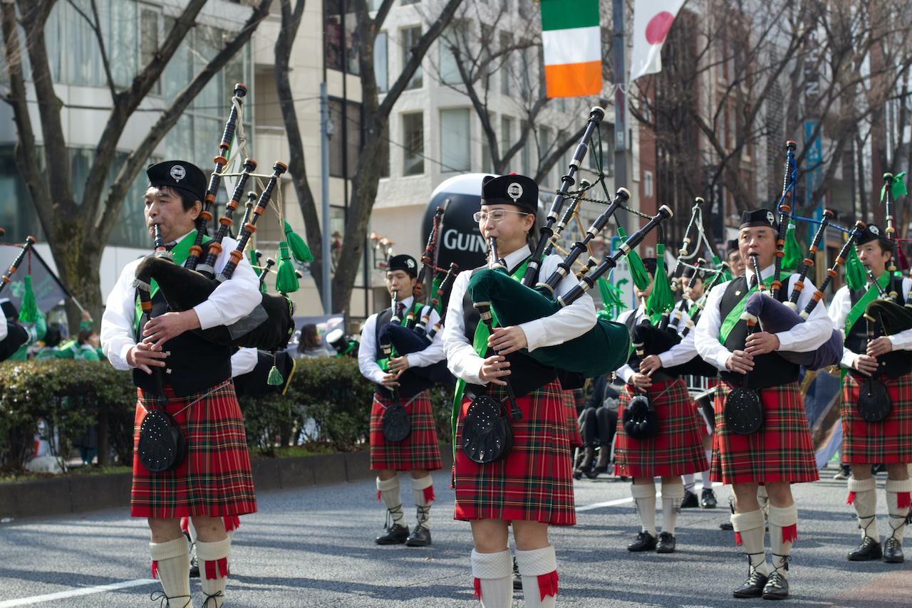People in traditional Irish outfits at parade in Tokyo