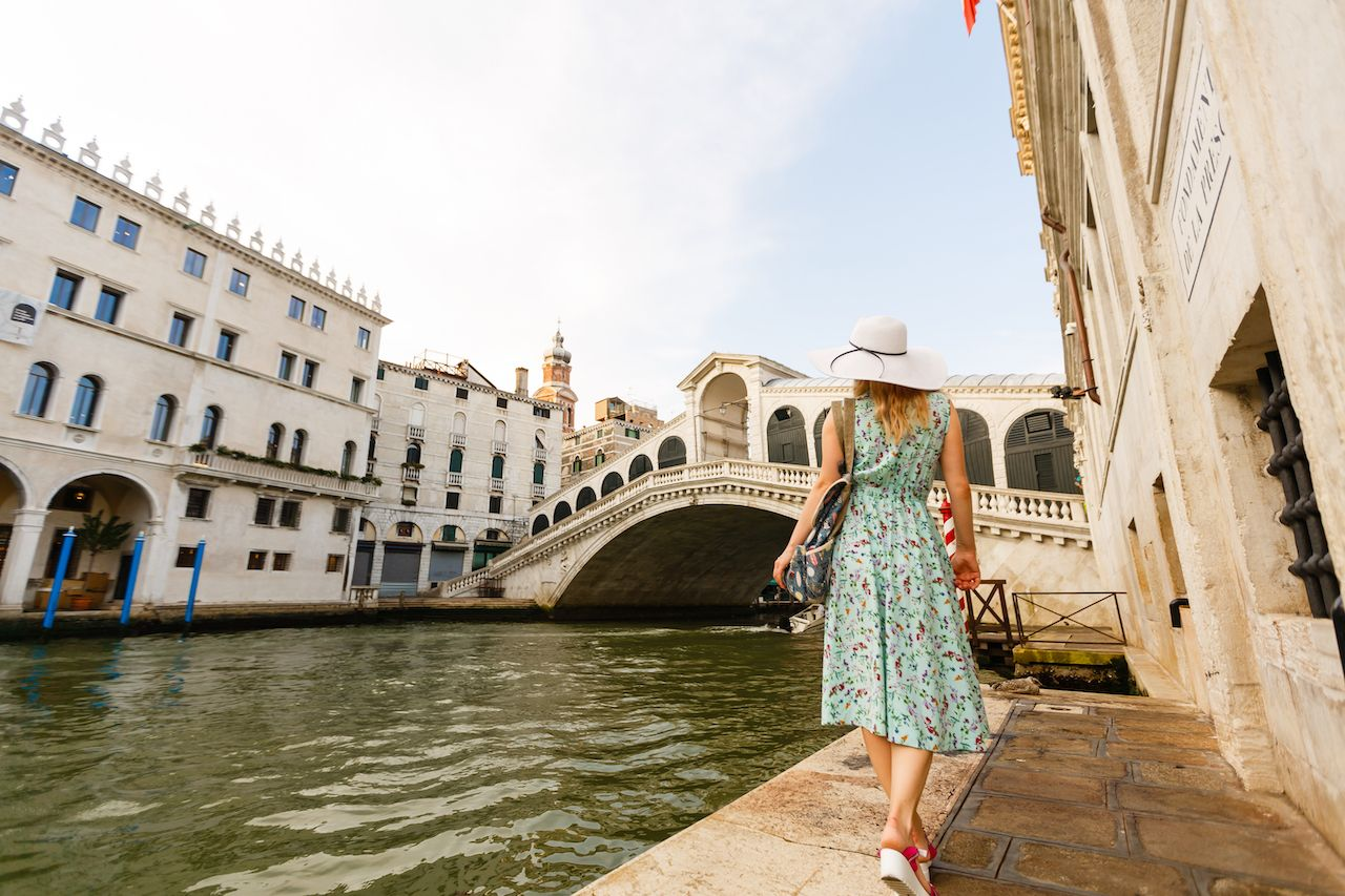 Tourist walking in venice