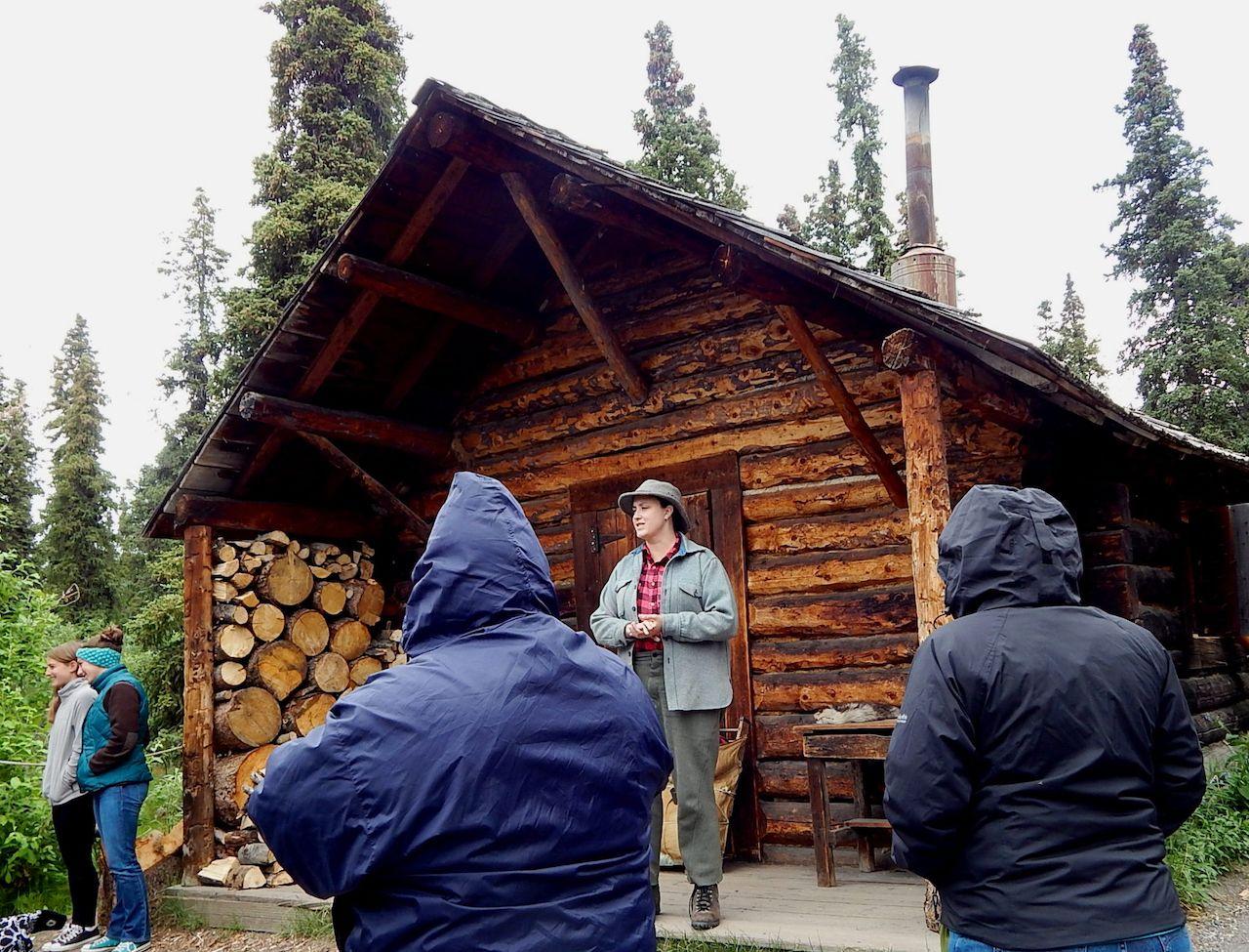 park ranger giving tourists a cabin tour at Denali National Park