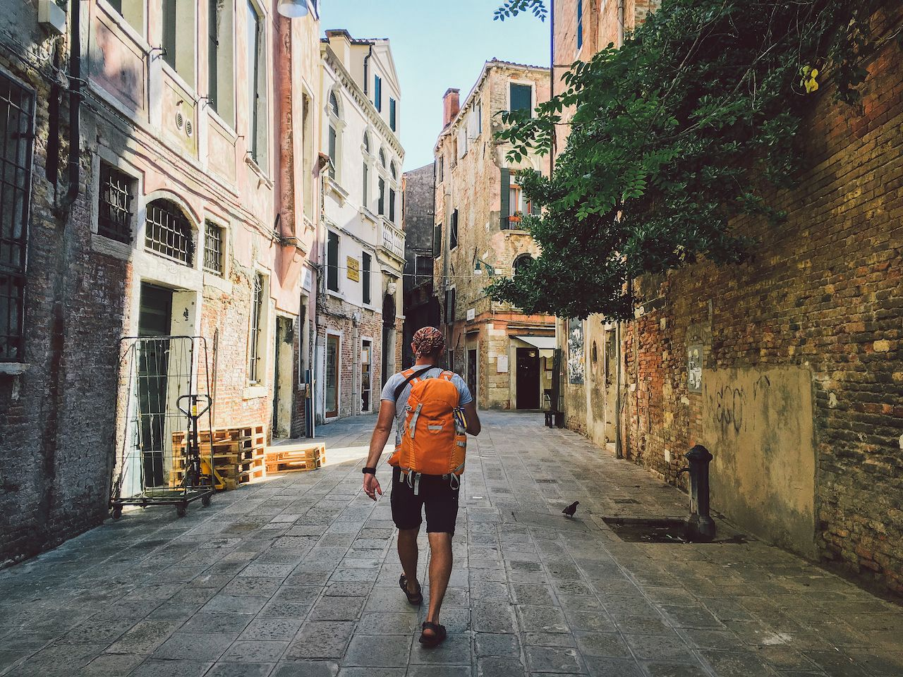 tourist walking in old part of venice