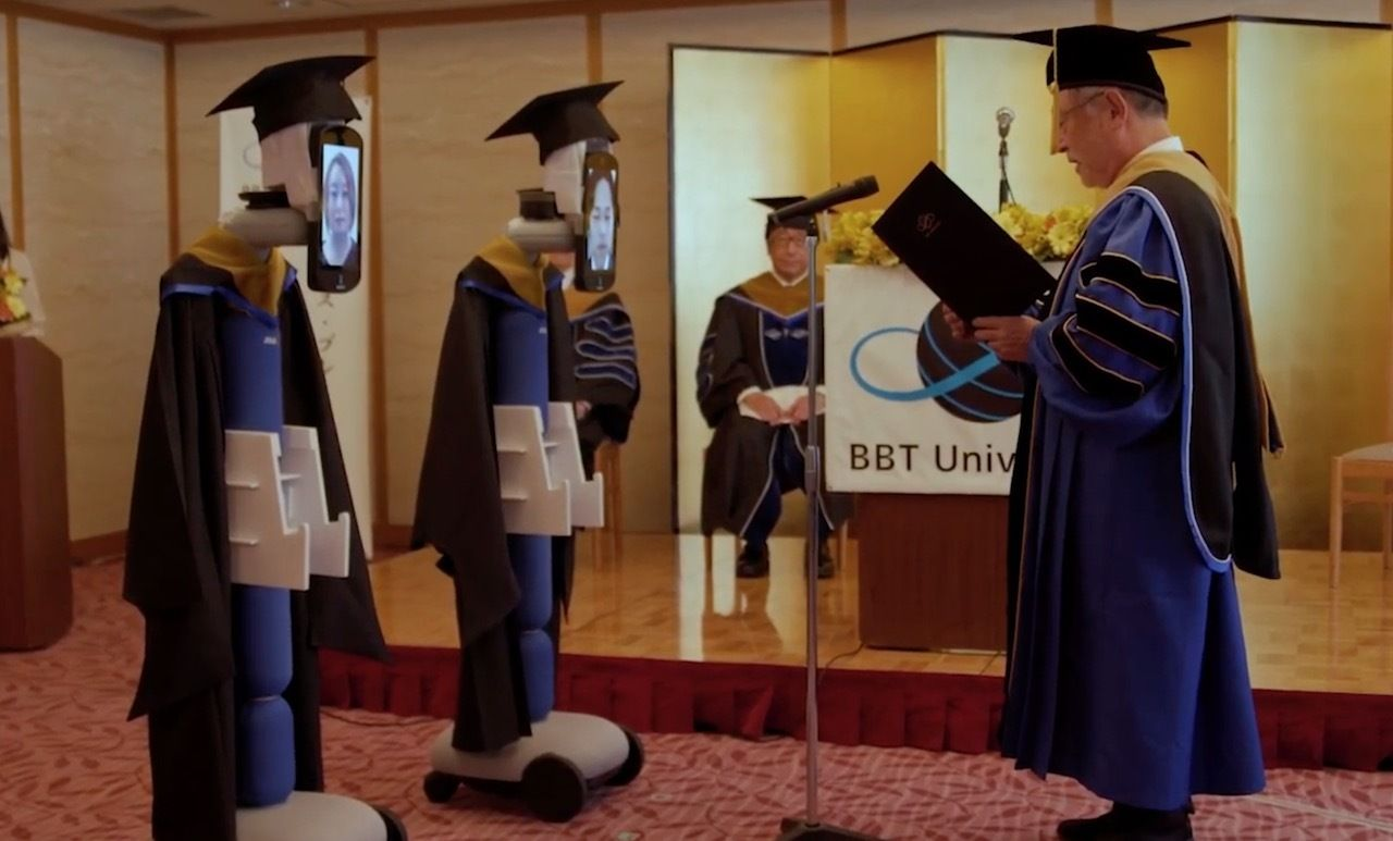 Avatar robots receiving diplomas in Japan