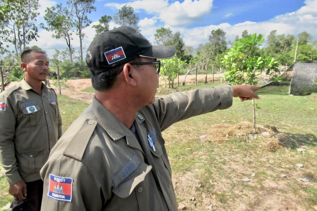 Chhun Bora points toward UXO's