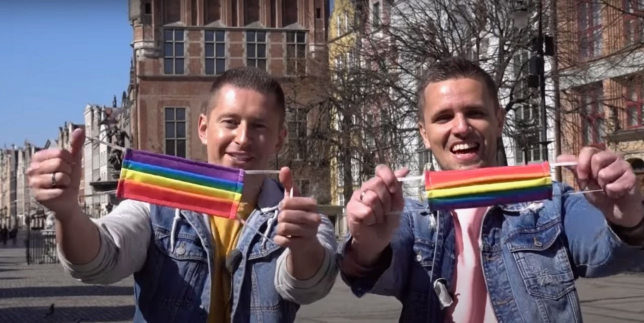 Gay couple handed out rainbow face masks in Poland