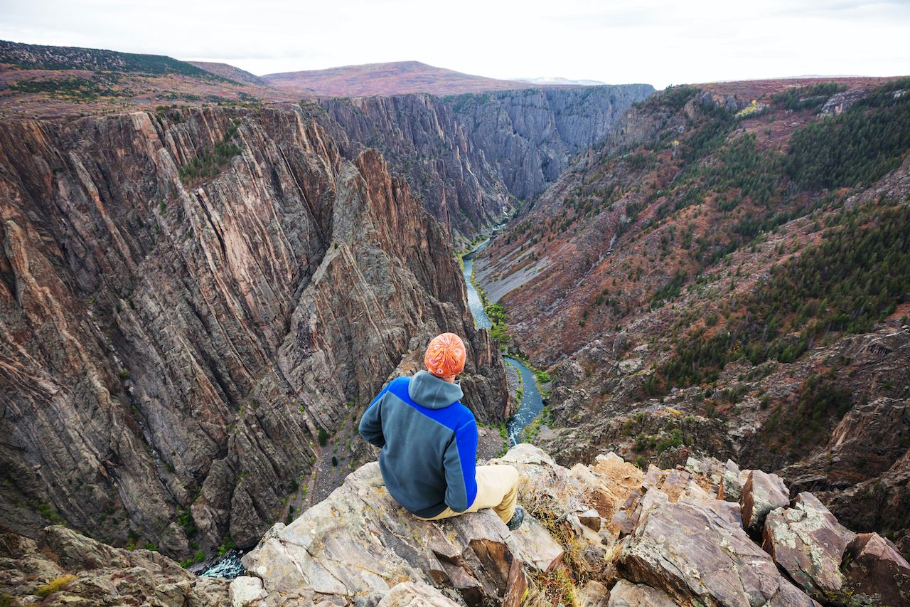 Tourist on the granite cliffs of the Black Canyon of the Gunnison, Colorado