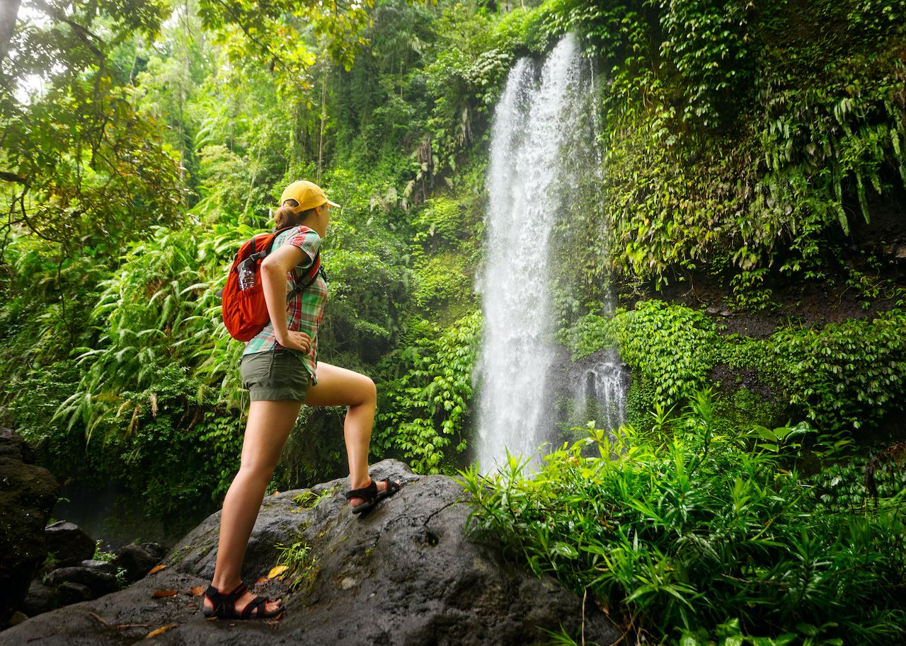 Hiker by a waterfall