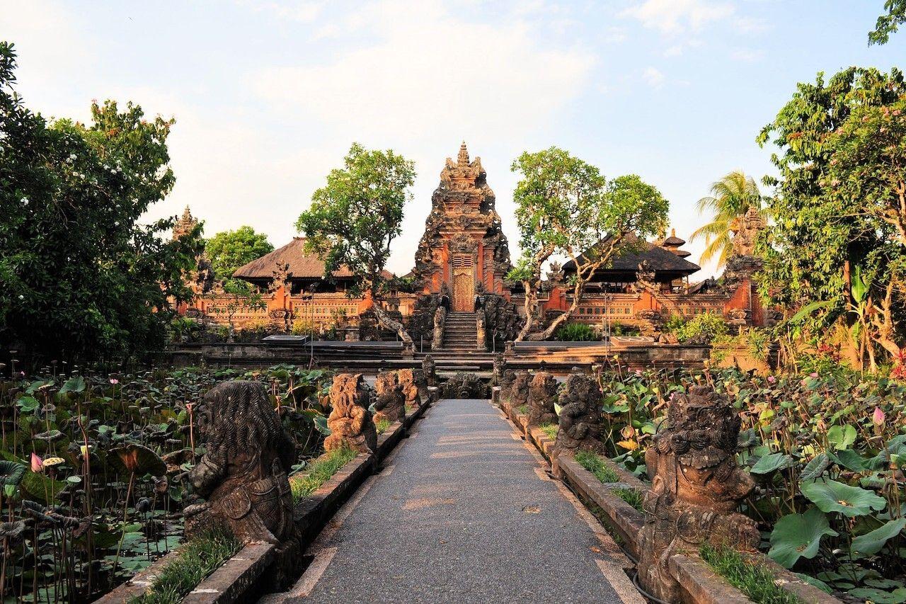 Lotus pond and Pura Saraswati temple in Ubud, Bali, Indonesia