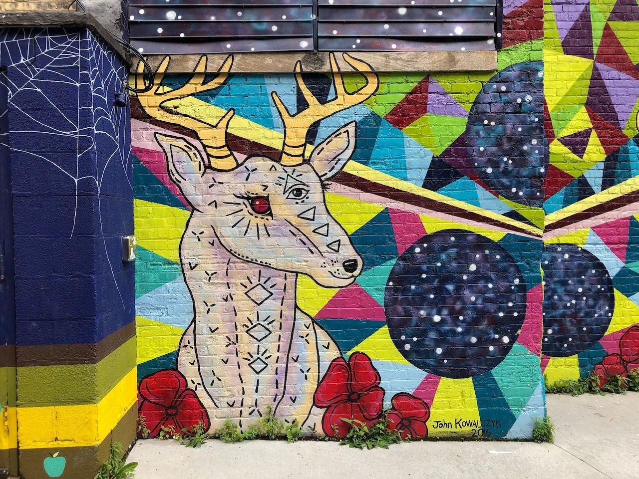 Mural of a deer in Black Cat Alley
