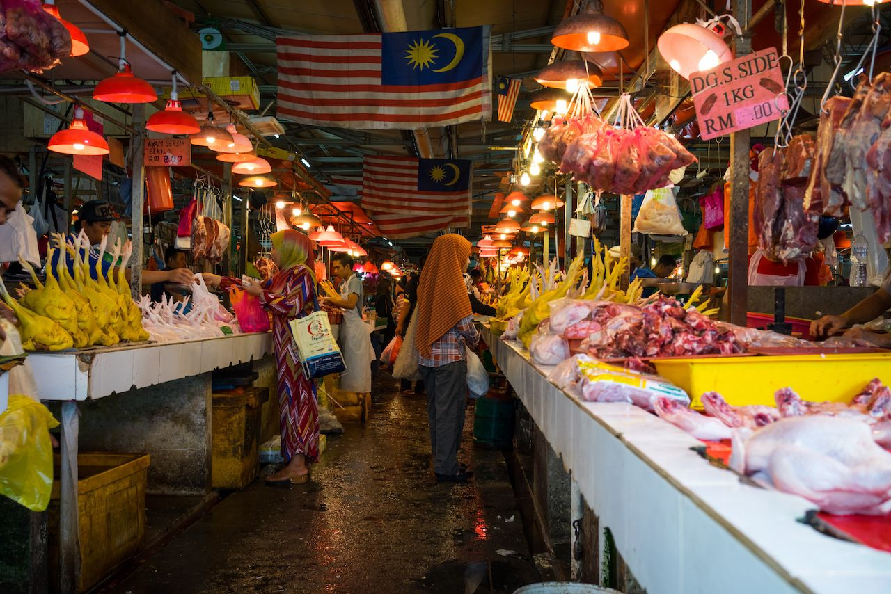 shoppers with their purchases in Bazaar Baru Chow Kit Kuala Lumpur