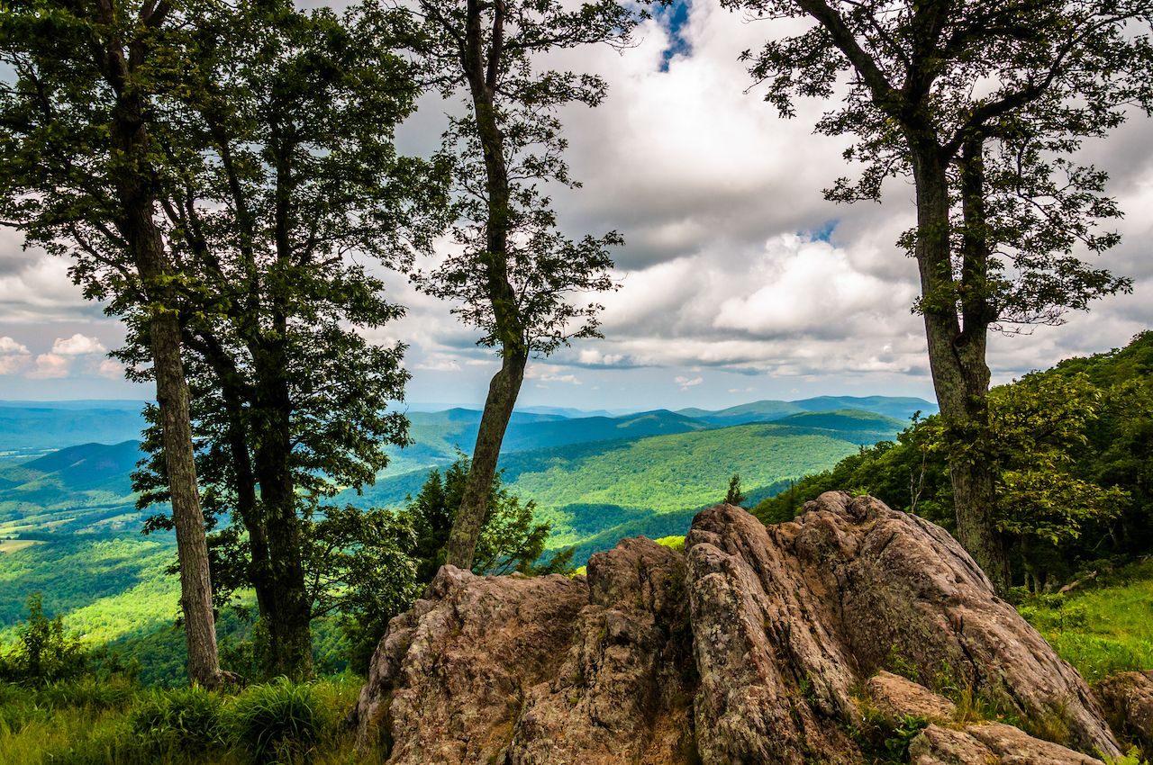 Boulders, trees, and view of the Blue Ridge at an overlook on Skyline Drive in Shenandoah National Park, Virginia