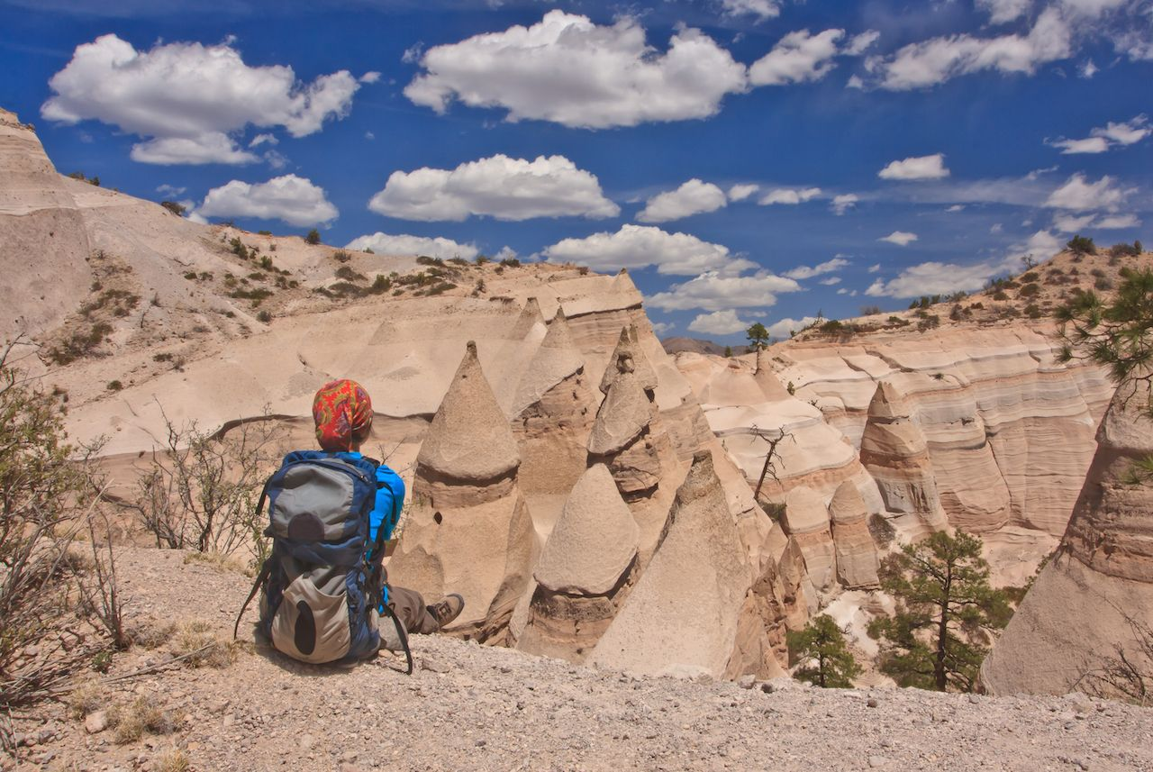 Hiker overlooking moon- like landscape in Kasha-Katuwe Tent Rocks National Monument