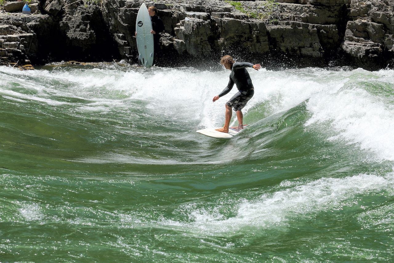 surfing on the white water rapids of the snake river in western Wyoming