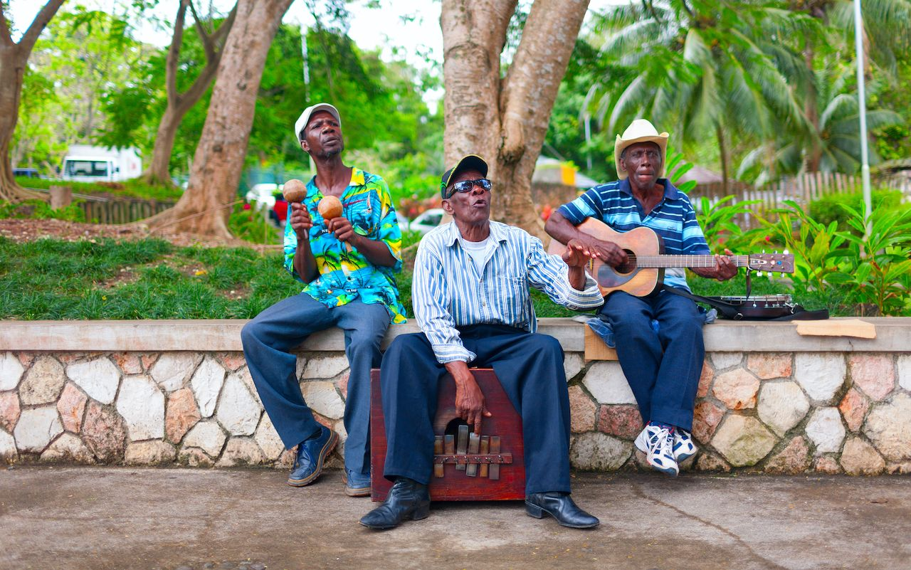 A group of local musicians are playing traditional music in Jamaica