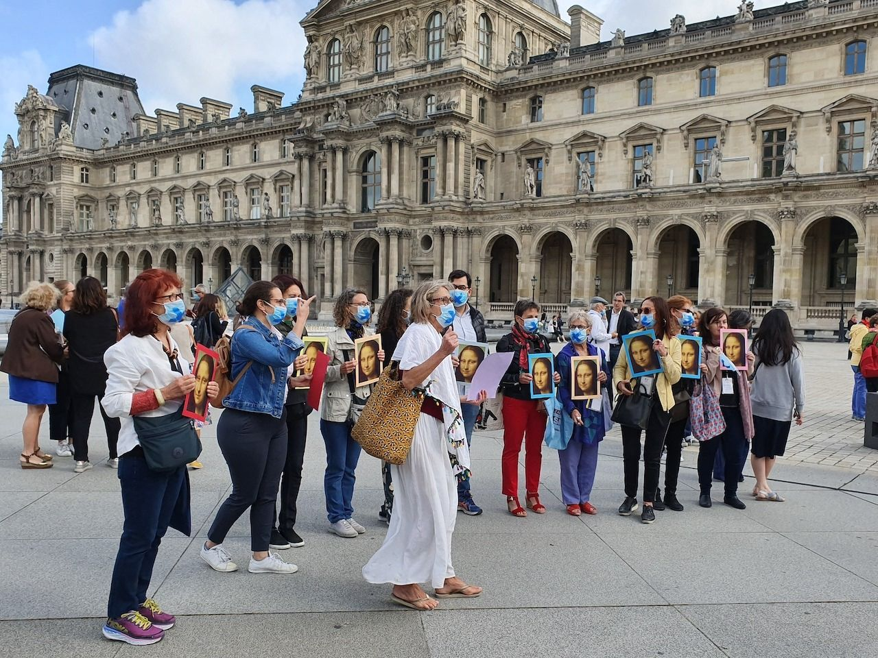 Tour guides protest in front of the louvre in Paris