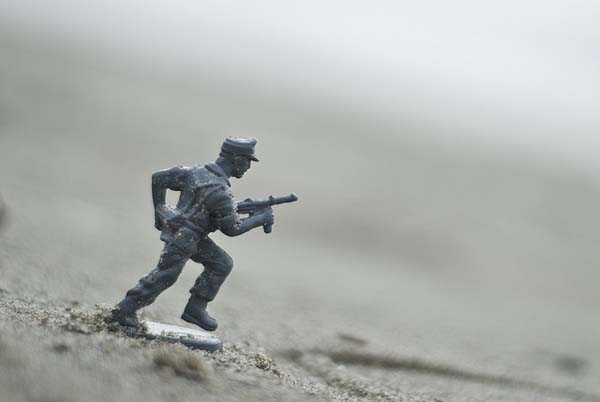 Toy soldier on beach