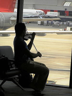 Playing Violin at Airport