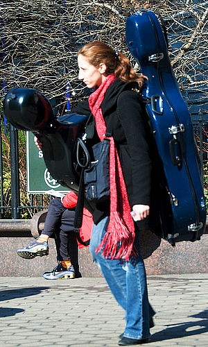 Woman carrying guitars