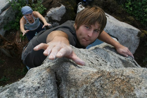 Bouldering: reaching for a hold