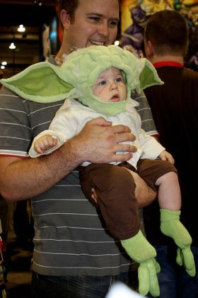 Baby dressed as Yoda