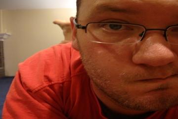 Geeky, pensive looking guy