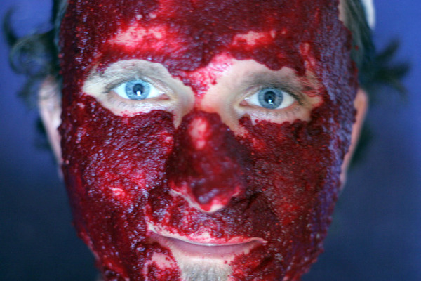 Man with cranberry face mask