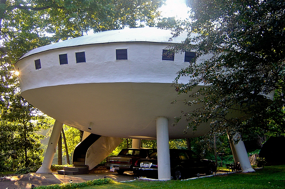 a UFO alien shaped house in the forest