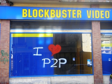 blockbuster movie rental shop with I love p2p tagged on the window