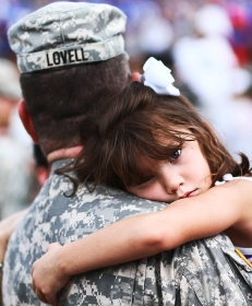 a little girl hugging a soldier portrait