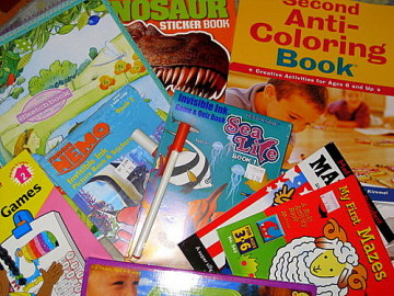 a pile of coloring books for children