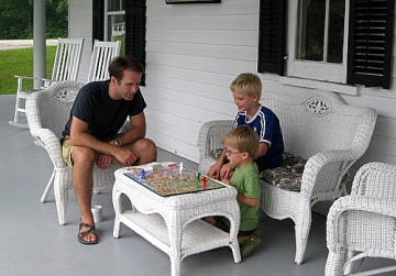 a family playing board games to relax during a road trip