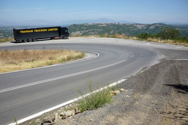 Transam truck rounding a hairpin bend in Greece