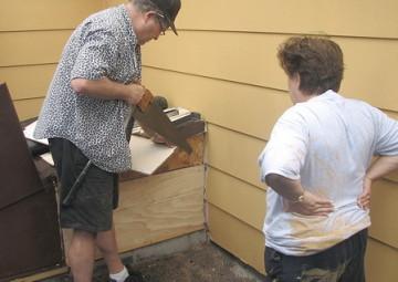 parents sawing