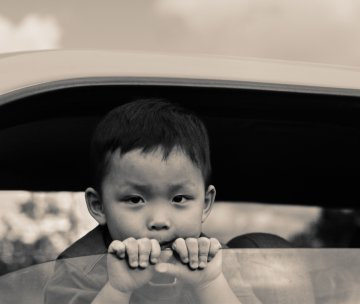 Asian child in car