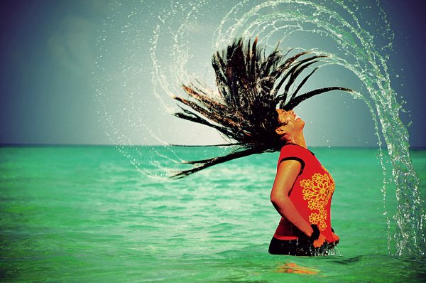 Girl in the ocean with crazy hair