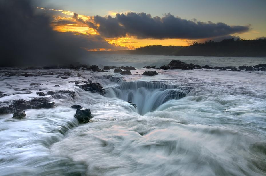 Lava ledge and ocean wave on Kauai, Hawaii
