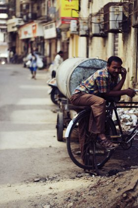 Man with bicycle in Mumbai, India