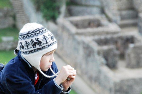 Child ponders Machu Picchu
