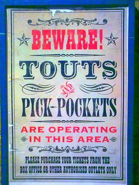 pickpockets and touts sign
