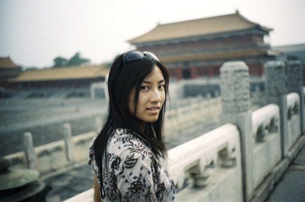 Woman in front of the Forbidden City, Beijing
