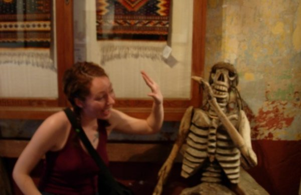 High fiving a Mexican skeleton